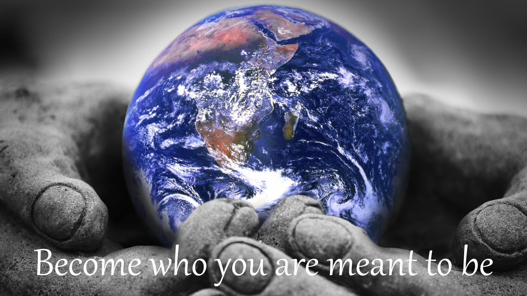 Earth held in a pair of hands - Become who you are meant to be